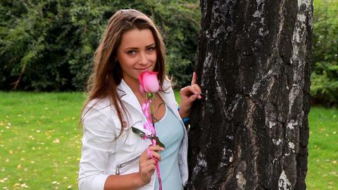Beautiful girl posing with rose Stock Video Footage
