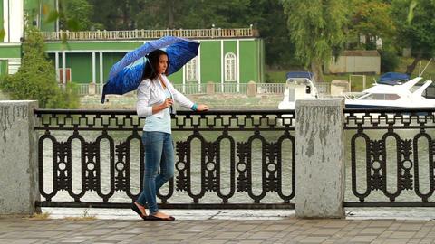 Beautiful girl posing with umbrella Stock Video Footage