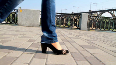 Tall, leggy girl is on the waterfront Stock Video Footage