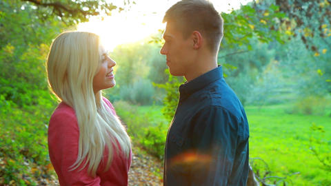 young couple on background of autumn trees Stock Video Footage