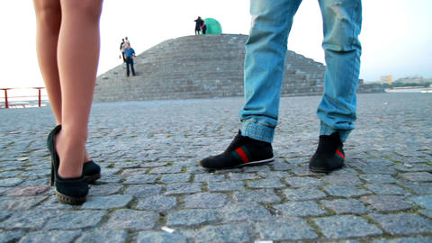 legs of young people on the waterfront Stock Video Footage