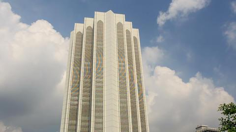 Skyscraper Menara Dayabumi against Clouds Motion Footage