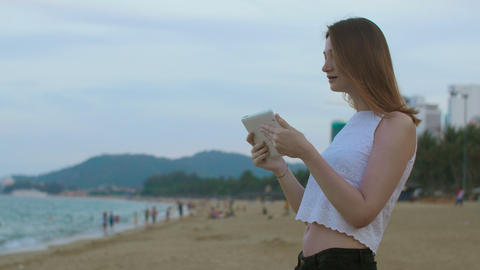 Girl talking with tablet at seaside Footage