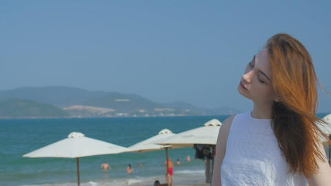 Portrait of beautiful woman on the seashore, slow motion Footage