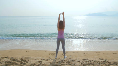 Young Woman On Her Workout On The Beach stock footage