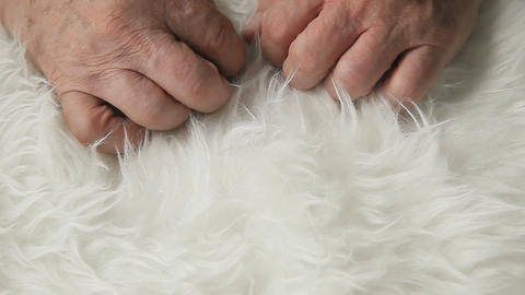 Man touches fake fur Footage