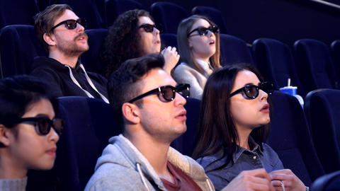 People watch 3D film at the movie theater Footage