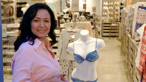 Woman chooses underwear at the boutique Live Action