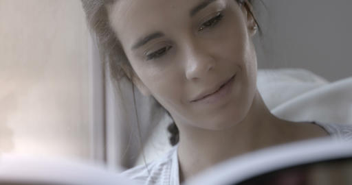 Close up of woman reading in bed – 4k Stock Video Footage