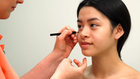 Beauty specialist uses cosmetic pencil Live Action