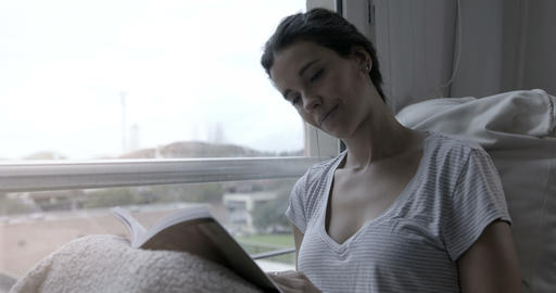 Woman reading in bed – 4k Stock Video Footage