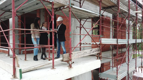 Female Gay Couple Buying New Home In Construction Site ビデオ