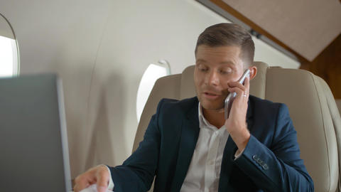 Happy mature businessman talk by phone partner connection aircraft jet travel Footage