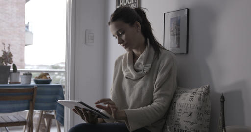 Woman with Ipad at home - 4K Footage