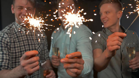 Happy New Year Celebrating Handsome Young Male Holding Bengal lights Footage