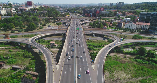 Traffic interchange. Road, cars, trucks. Camera travels above the road Footage
