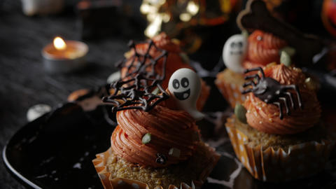 Fancy Halloween food Party Table with Pumpkin Cupcake Muffin and cookies ビデオ