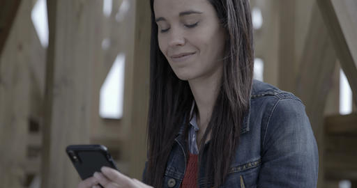 Woman browsing and texting on her phone outdoors by the… Stock Video Footage