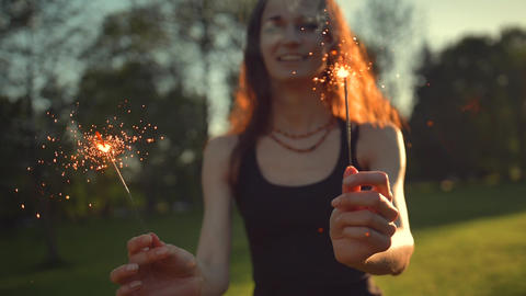 A young woman with a sparkler Footage