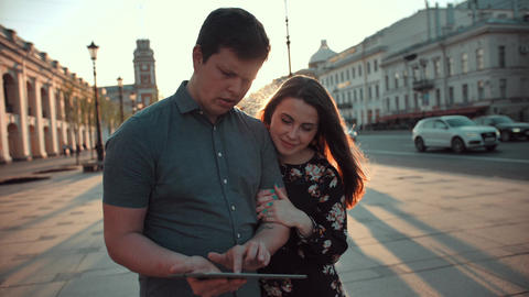 Man and woman use digital pad device for navigation Footage
