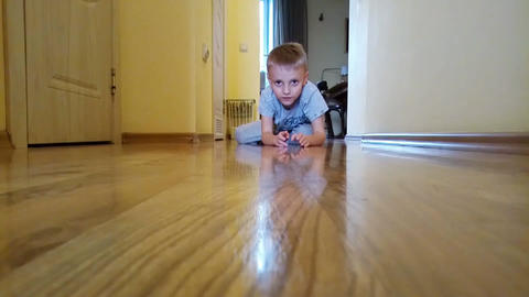 Little boy playing with car on the floor Footage