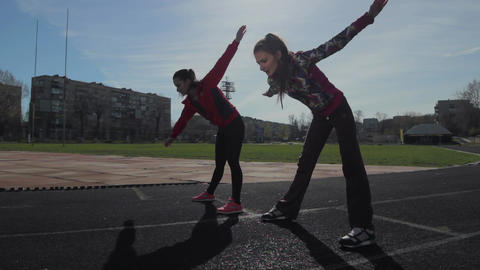 Young girls spend training exercises before the race. Exercise for warming the Footage