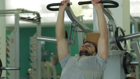 Man doing exercise for the chest muscles Live Action