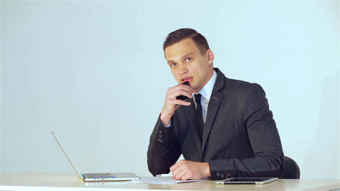 Young businessman listens attentively Live Action
