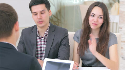 Young attractive couple consults about their business project Footage