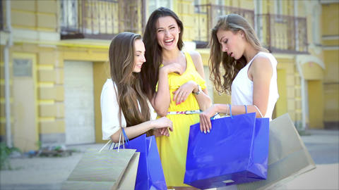 Three cute girls meet while shopping, and consider buying fashion Footage