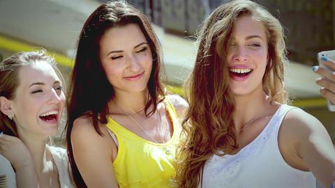 Three pretty girls-shopaholic make selfieie after shopping Live Action