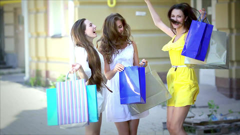 Three pretty girls-shopaholic jumping for joy after shopping Live Action