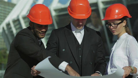 Three confident business architect in protective helmet Footage