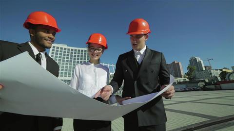 Three confident business architect Live Action