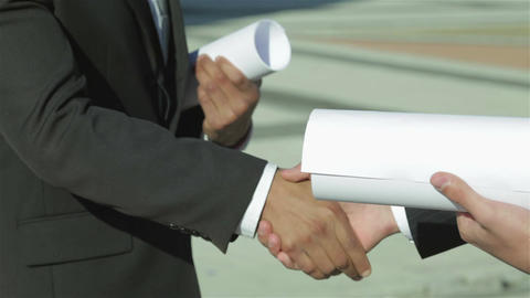 Two confident engineer shaking hands in formalwear Footage