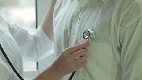 A stethoscope on the patient's chest Live Action