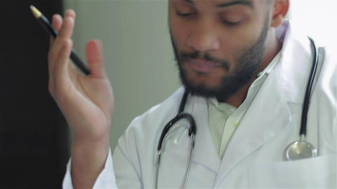 The doctor spreads his hand and writes on the examination of the patient Live Action