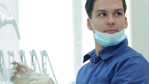 Dentist looking at the assistant and smiling Live Action
