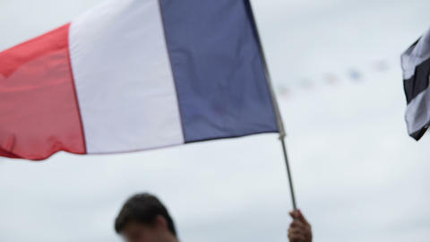 Patriots waving national flag of France, supporting sports team at competition Live Action