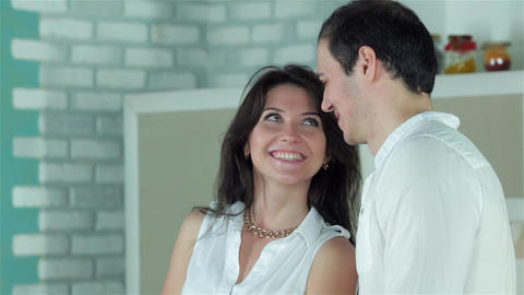 Couple looking eye to eye with tenderness while cooking dinner Footage
