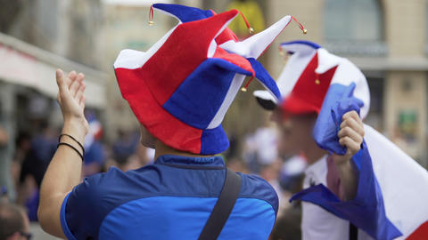 Fans of French soccer team clapping hands and whistling supporting favourites Live Action