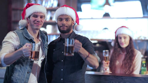 Two friends in Santa hats and the girl behind the bar is welcomed new friends Live Action