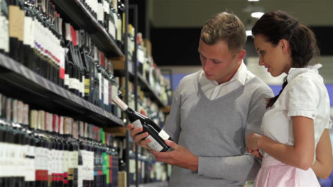 American shoppers choosing at liquor store Footage