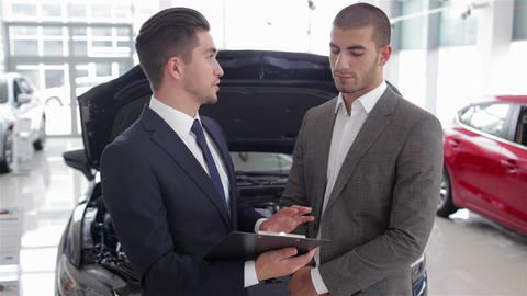 Salesman in a motor show Live Action
