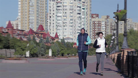 Fit fitness exercise people, healthy runners running in city cityscape skyline Live Action