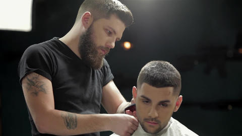 Men's hairstyling and haircutting in a barber shop Live Action