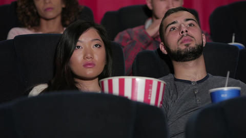 Happy couple at the cinema Live Action