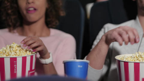 Couple in cinema theater eating popcorn Footage