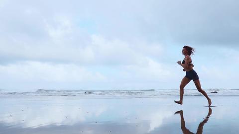 Running woman outdoors beach run. Atlantic ocean Footage
