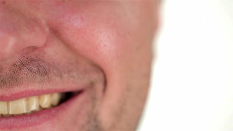 Half of the human face unshaven and smile Live Action